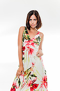 Young woman in modern floral summer dress on white background Model release available