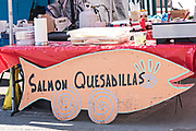 A food stall selling salmon quesadillas and reindeer sliders at the weekly Farmers Market in downtown Anchorage, Alaska.