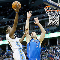 06 March 2016: Denver Nuggets guard Emmanuel Mudiay (0) goes for the layup against Dallas Mavericks center Zaza Pachulia (27) during the Denver Nuggets 116-114 overtime victory over the Dallas Mavericks, at the Pepsi Center, Denver, Colorado, USA.