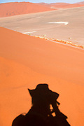 Shadow cast by the photographer (Amos Gal RIP)on a sand dune ridge at Sossusvlei, Namib-Naukluft National Park, Namibia.