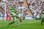 Mark Ellis (Forest Green Rovers) clears the ball as Cole Stockton (Tranmere Rovers) closes him down during the Vanarama National League Play Off Final match between Tranmere Rovers and Forest Green Rovers at Wembley Stadium, London, England on 14 May 2017. Photo by Mark P Doherty.