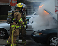 Oxford firemen extinguish a car fire on the Square in Oxford, Miss. on Tuesday, March 2, 2010.