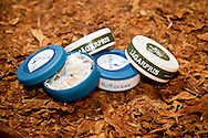 Portionsnus, Blue Ocean and Jagerpris, laying on raw tobacco plants at the Danish manufacturer AG Snus, a subsidiary of Assens Tobaccofactory. PHOTO: ERIK LUNTANG / INSPIRIT Photo.