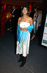 "Children's TV presenter KONNIE HUQ at the 10th annual British Red Cross London Ball.  This years ball theme was Indian based - ""Yaksha - Yakshi: Doorkeepers to the Divine"" and was held at The Room, Upper Ground, London on 1st December 2004.  Proceeds from the ball will aid vital humanitarian work, including HIV/AIDS projects that the Red Cross supports in the UK and overseas.<br />