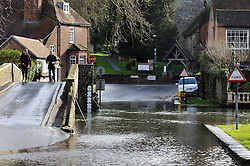 © Licensed to London News Pictures. 28/01/2014<br /> Wet and cold weather conditions continue across the UK. <br /> The river Darent water level in Eynsford,Kent remains high flooding parts of the Riverside at the Ford. <br /> Photo credit :Grant Falvey/LNP