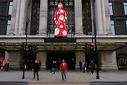 Giant model of artist Yakoi Kusama whose collaboration between Louis Vuitton and Selfridges whose red campaign theme accompanies a life size model of the artist in the department store windows and Oxford Street entrance.