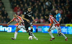STOKE-ON-TRENT, ENGLAND - Monday, October 31, 2011: Newcastle United's Jonas Gutierrez in action against Stoke City during the Premiership match at the Britannia Stadium. (Pic by David Rawcliffe/Propaganda)