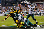 21 Sept 2008: Philadelphia Eagles defensive end Trent Cole #58 brings down Pittsburgh Steelers quarterback Ben Roethlisberger #7 in the end zone during the game against the Pittsburgh Steelers on September 21st, 2008.  The Eagles won 15-6 at Lincoln Financial Field in Philadelphia Pennsylvania.