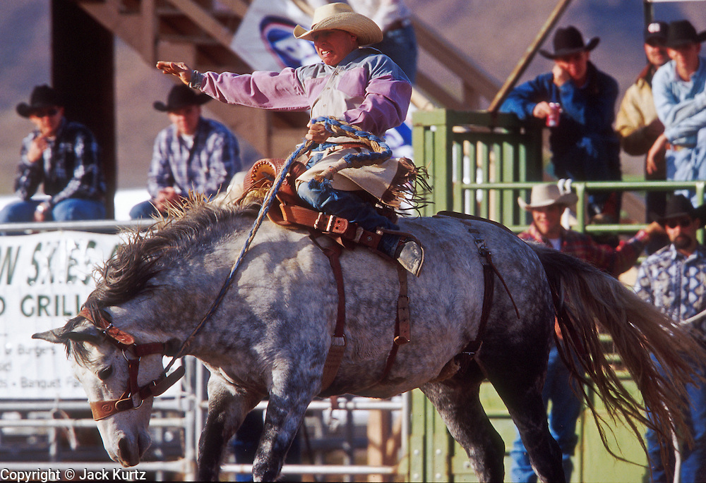 24 NOVEMBER 2001 - APACHE JUNCTION, ARIZONA, USA: Saddle bronc riding at the 2001 Superstition Mountain Stampede in Apache Junction, AZ, Nov 24, 2001. The rodeo is a fundraiser for charities in Apache Junction, which is about 40 miles from Phoenix. .PHOTO BY JACK KURTZ