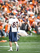 SHOT 7/25/13 9:45:53 AM - Denver Broncos wide receiver Wes Welker #83 walks off the field during opening day of the team's training camp July 25, 2013 at Dove Valley in Englewood, Co. Welker was a key addition in the off season after playing for years in New England. (Photo by Marc Piscotty / © 2013)