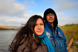 CANADA ALBERTA PACE RIVER 12OCT09 - Melina Laboucan-Massimo and her father Billy Joe Laboucan of the Lubicon Cree band of First Nations stand outside at Peace River in northern Alberta, Canada...Photo by Jiri Rezac / GREENPEACE