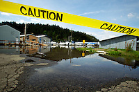 Flood waters submerge the entrance to a row of float homes Monday on Blackwell Island as the high lake level has caused minor flooding in a number of areas in the Coeur d'Alene area.