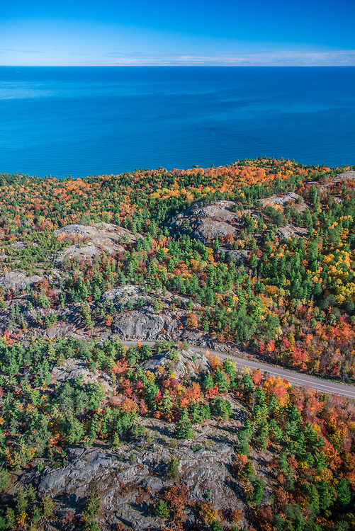 Aerial photography of  the rugged Lake Superior shoreline north of Marquette, Michigan during fall color season. Areas shown include County Road 550 rock cut and Sugarloaf Mountain lookout.