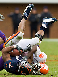 Virginia running back Cedric Peerman (37) is tackled by Clemson cornerback Byron Maxwell (36).  The Clemson Tigers defeated the Virginia Cavaliers 13-3 in NCAA Division 1 football at Scott Stadium on the Grounds of the University of Virginia in Charlottesville, VA on November 22, 2008.