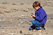 Child (age 7) exploring on Sand Dollar Beach, Big Sur Coast, California