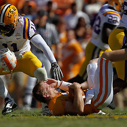 Oct 2, 2010; Baton Rouge, LA, USA;LSU Tigers linebacker Kelvin Sheppard (11) sacks Tennessee Volunteers quarterback Matt Simms (2) during the first half at Tiger Stadium.  Mandatory Credit: Derick E. Hingle