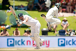 England's Kevin Pietersen hits the ball past South Africa's Hashim Amla during the First Test at the SuperSport Park, Centurion, South Africa.