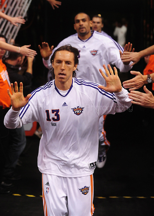 May 29, 2010; Phoenix, AZ, USA; Phoenix Suns guard Steve Nash (13) is high fived by fans prior to the first quarter in game six of the western conference finals in the 2010 NBA Playoffs at US Airways Center.  Mandatory Credit: Jennifer Stewart-US PRESSWIRE