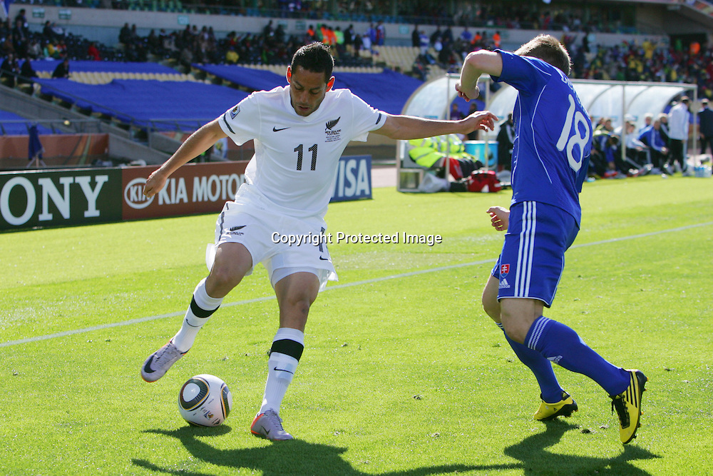 Leo Bertos of New Zealand  battles with Erik Jendrisek of Slovakia  during the the FIFA World Cup 2010 match between New Zealand and Slovakia at The Royal Bafokeng stadium in Rustenburg, South Africa on the 15th June 2010<br /> <br /> <br /> Photo by Ron Gaunt/Sportzpics/PHOTOSPORT