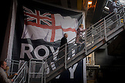 Visitors climb stairs from the hangar deck to the upper top deck while touring the hangar deck on-board the Royal Navy's aircraft carrier HMS Illustrious during a public open-day in Greenwich. Illustrious docked on the river Thames, allowing the tax-paying public to tour its decks before its forthcoming decommisioning. Navy personnel helped with the PR event over the May weekend, historically the home of Britain's naval fleet.