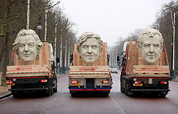 EDITORIAL USE ONLY<br /> Three 8 foot models of the heads of The Grand Tour presenters, Jeremy Clarkson, James May and Richard Hammond travel down The Mall in London on the back of flatbed trucks after travelling 30,000 miles across 3 continents.