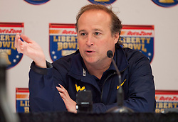 West Virginia head coach Dana Holgorsen speaks with the media one day before the Liberty Bowl in Memphis, TN.