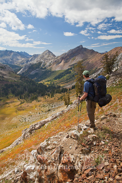 A backpacker pauses to admire the impressive view of Jackson Peak and the Imnaha River Valley, Eagle Cap Wilderness, Oregon