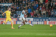 Ishmael Miller (Huddersfield Town) shoots to score Huddersfields second of the game during the Sky Bet Championship match between Huddersfield Town and Rotherham United at the John Smiths Stadium, Huddersfield, England on 15 December 2015. Photo by Mark P Doherty.