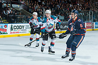KELOWNA, CANADA - MARCH 31: Carsen Twarynski #18 and Tomas Soustal #15 of the Kelowna Rockets look for the pass beside Dallas Valentine #6 of the Kamloops Blazers on March 31, 2017 at Prospera Place in Kelowna, British Columbia, Canada.  (Photo by Marissa Baecker/Shoot the Breeze)  *** Local Caption ***