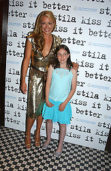 Left to right, CAT DEELEY and KATY VOOS  at a party to promote the Kiss It Better campaign for the Great Ormond Street Hospital in association with Stila and Space.NK held at Frankie's, Yeoman's Row, London on 31st May 2005.<br />
