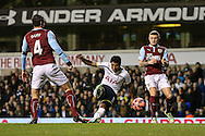 Paulinho of Tottenham Hotspur (centre) scores his team's first goal against Burnley to make it 1-2 during the FA Cup match at White Hart Lane, London<br /> Picture by David Horn/Focus Images Ltd +44 7545 970036<br /> 14/01/2015