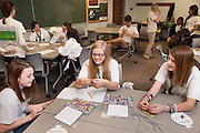 Students Cydney Jones, Arden Gillette, and Kilee Samson build braclets from a decoded message in a DNA strand during the Tech Savvy workshop at Ohio University May 17, 2014.  The full day event exposes girls from sixth through ninth grade to the field of science, technology, engineering and math.    Photo by Ohio University / Jonathan Adams