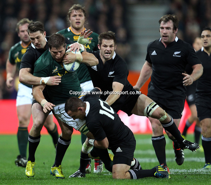 Willem Alberts of South Africa is tackled by Aaron Cruden, Cory Jane and Richie McCaw.<br /> The Rugby Championship - All Blacks v South Africa, 15 September 2012, Forsyth Barr Stadium, Dunedin, New Zealand.<br /> Photo: Rob Jefferies/PHOTOSPORT