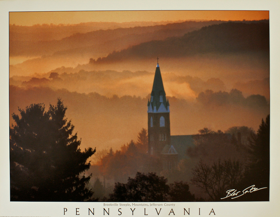 """Poster of a church steeple in Brookville punctuating the morning mist, Jefferson County, Pennsylvania. White border with word """"Pennsylvania"""" at bottom with space for frame"""
