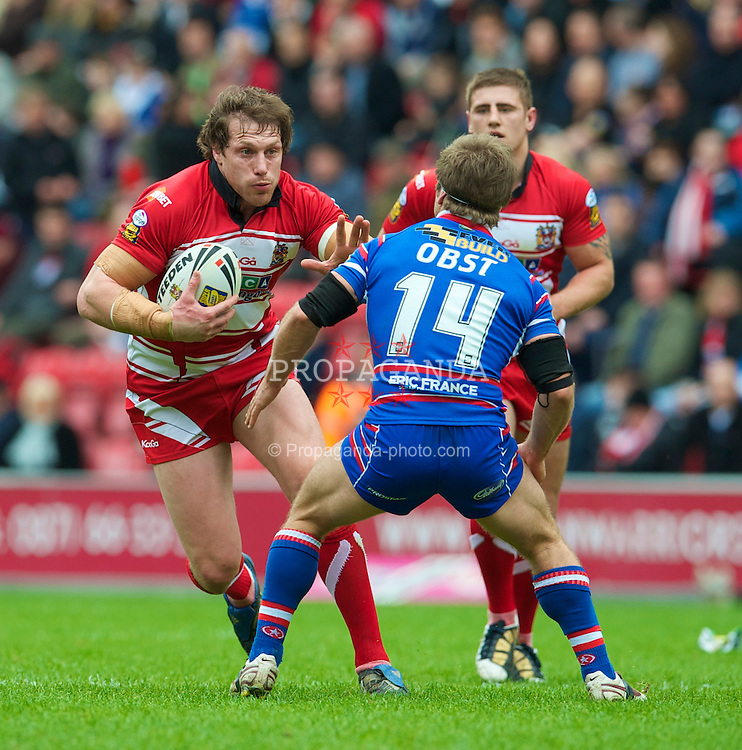 WIGAN, ENGLAND - Monday, April 5, 2010: Wigan Warriors' Andy Coley and Wakefield Wildcats' Sam Obst during the Super League XV Round 10 match at the DW Stadium. (Pic by David Rawcliffe/Propaganda)