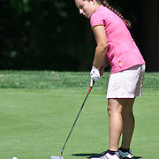 06/30/11 Newark DE: Golfer Maddie Silverman (17) punting from the green on hole 12 during round two of the DSGA and DWGA junior golf championships Thursday, June 30, 2011 at Newark Country Club in Newark Delaware.