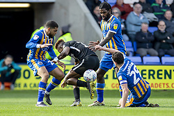 March 23, 2019 - Meadow, Shropshire, United Kingdom - Scott Golbourne, Anthony Grant and Oliver Norburn of Shrewsbury Town surround Jamal Lowe of Portsmouth FC during the Sky Bet League 1 match between Shrewsbury Town and Portsmouth at Greenhous Meadow, Shrewsbury on Saturday 23rd March 2019. (Credit Image: © Mi News/NurPhoto via ZUMA Press)