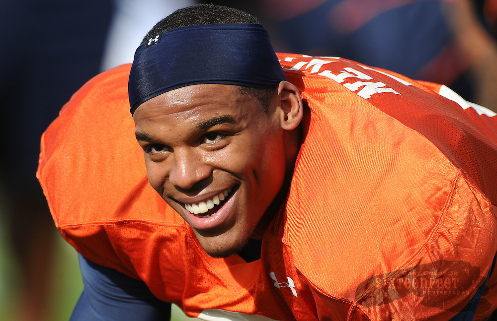 Daily Photo by Gary Cosby Jr.   ..Cam Newton wears his trademark smile during Auburn's practice at Scottsdale Community College Thursday..