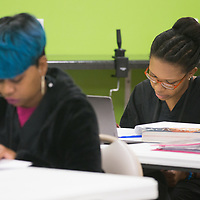 Student Alisá Hill reads the answer to a test question aloud in the junior and senior level classroom at the Tupelo Academy of Cosmetology. Students enrolled in the day time program, like Hill, can complete the program in around 12 months.