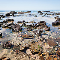 Photo of Orange County California rock formations at Crystal Cove State Park. Crystal Cove is located along the Pacific Ocean in Laguna Beach and Newport Beach in Southern California.