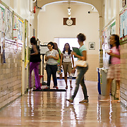 July 9, 2009 - Bronx, NY : The students walk the main corridor of Miguel Hall on their way to their breakout writing sessions. A group of 15 local high school students participated in the Kingsbridge Heights Community Center-sponsored summer literacy institute, an intensive 4-day college prep course.  The students, broken down into smaller groups and aided by student writing coaches and english teachers (Manhattan college students and alumns respectively) spent a total of 7-8 hours over three days discussing the college application process and preparing mock college application essays to be presented at a banquet on the fourth day.