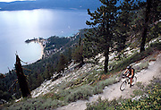 A mountain biker rides along the great Flume Trail above Sand Harbor on Lake Tahoe's East shore. The flume trail is one of the most popular and scenic rides along the lake and less than an hour from Reno.