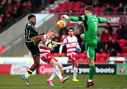 Ellis Harrison of Bristol Rovers challenges Craig Alcock and Ian Lawlor of Doncaster Rovers - Mandatory by-line: Robbie Stephenson/JMP - 27/01/2018 - FOOTBALL - The Keepmoat Stadium - Doncaster, England - Doncaster Rovers v Bristol Rovers - Sky Bet League One