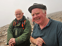 Tommy Murphy Killcogy Co Cavan and Patsy Costello Virginia Co Cavean near the summit of Croagh Patrick despite the cancellation notices on account of the adverse weather conditions many pilgrims continued up to the summit of Croagh Patrick on reek sunday .<br /> Pic Conor McKeown