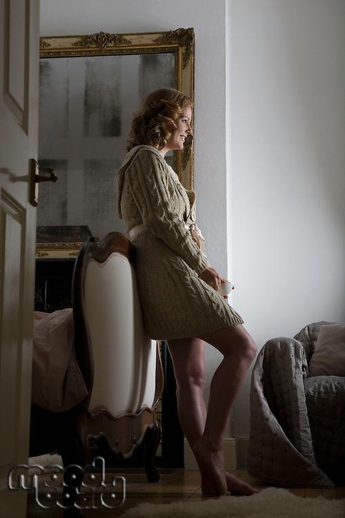 Mid adult woman wearing bathrobe