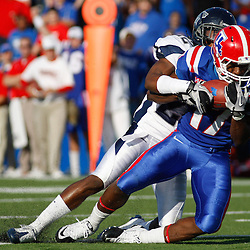 December 4, 2010; Ruston, LA, USA;  Louisiana Tech Bulldogs wide receiver Taulib Ikharo (17) catches a pass over Nevada Wolf Pack cornerback Thaddeus Brown (22) during the first half at Joe Aillet Stadium.  Mandatory Credit: Derick E. Hingle