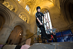 &copy; Licensed to London News Pictures 15/02/2017, Malmesbury, UK. The &quot;Malmesbury Abbey Skate&quot; now in its's 9th year, where the interior of the 12th century abbey in Malmesbury, Wiltshire is turned into a skate park for 3 days during the February half term. Pictured here: 13 year old Kyri Chackarou on his scooter.<br /> Photo Credit : Stephen Shepherd/LNP
