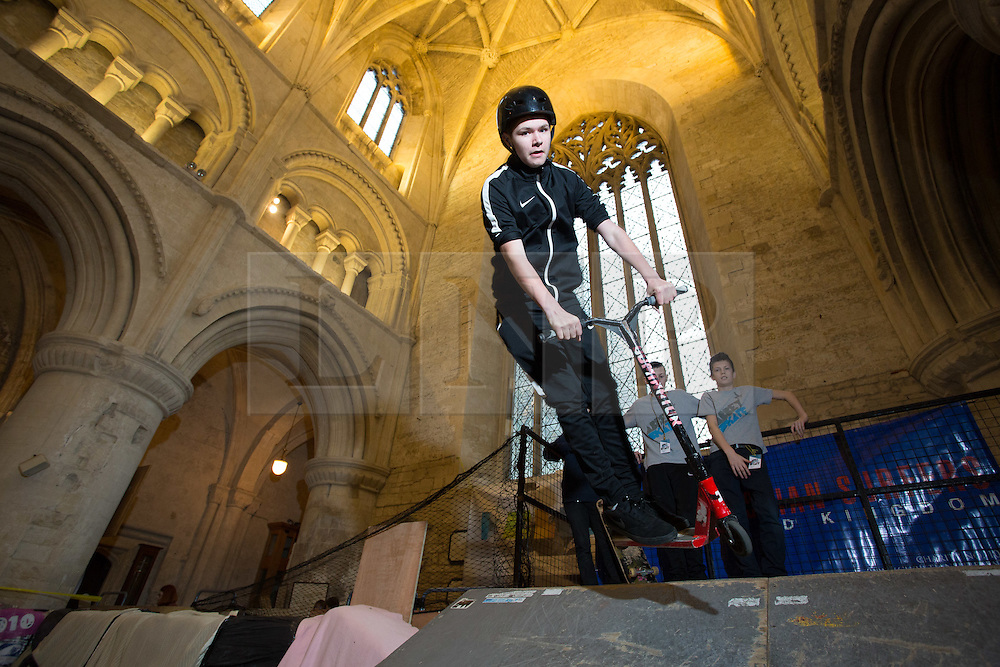 "© Licensed to London News Pictures 15/02/2017, Malmesbury, UK. The ""Malmesbury Abbey Skate"" now in its's 9th year, where the interior of the 12th century abbey in Malmesbury, Wiltshire is turned into a skate park for 3 days during the February half term. Pictured here: 13 year old Kyri Chackarou on his scooter.<br /> Photo Credit : Stephen Shepherd/LNP"