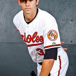 February 26, 2011; Sarasota, FL, USA; Baltimore Orioles starting pitcher Jake Arrieta (34) poses during photo day at Ed Smith Stadium.  Mandatory Credit: Derick E. Hingle