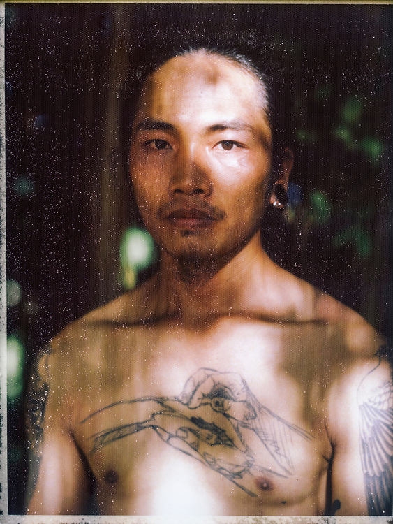 A portrait of a tattooed Vietnamese man.